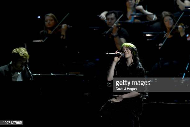 Billie Eilish performs on stage at The BRIT Awards 2020 at The O2 Arena on February 18 2020 in London England
