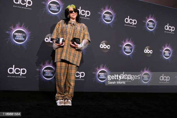 Billie Eilish poses in the press room at the 2019 American Music Awards at Microsoft Theater on November 24 2019 in Los Angeles California