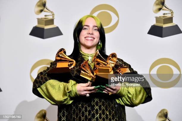 Billie Eilish poses with her awards in the press room during the 62nd Annual GRAMMY Awards at STAPLES Center on January 26, 2020 in Los Angeles,...