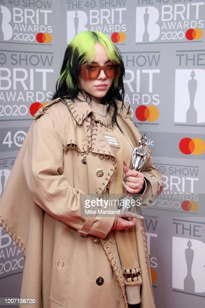 Billie Eilish poses with the International Female Solo Artist award in the winners rooms at The BRIT Awards 2020 at The O2 Arena on February 18 2020...