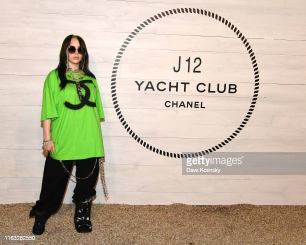 Billie Eilish wears a printed black and white jumpsuit Look 56 from the FallWinter 2019/20 act 1 ReadytoWear Collection with a white lacquered...