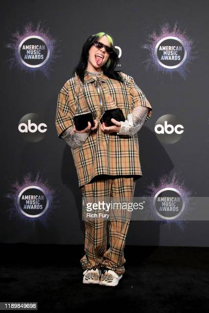 Billie Eilish winner of New Artist of the Year and Favorite Artist Alternative Rock poses in the press room during the 2019 American Music Awards at...