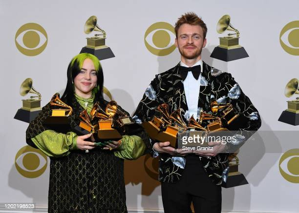 R Billie Eilish winner of Record of the Year for Bad Guy Album of the Year for when we all fall asleep where do we go Song of the Year for Bad Guy...