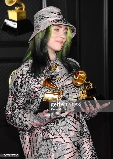 """Billie Eilish, winner of Record of the Year for 'Everything I Wanted' and Best Song Written For Visual Media for """"No Time To Die"""", poses in the media..."""