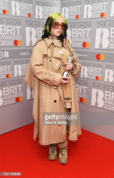Billie Eilish winner of the Best International Female Solo Artist award poses in the winners room at The BRIT Awards 2020 at The O2 Arena on February...