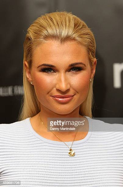 Billie Faiers attends a photocall to launch The Signature Range at Mothercare Oxford Street on November 28 2014 in London England