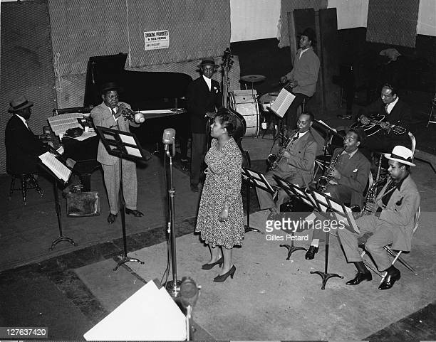 Billie Holiday in the studio at a recording session in New York LR Sonny White piano Roy Eldridge trumpet John Williams bass Billie Holiday Hal West...