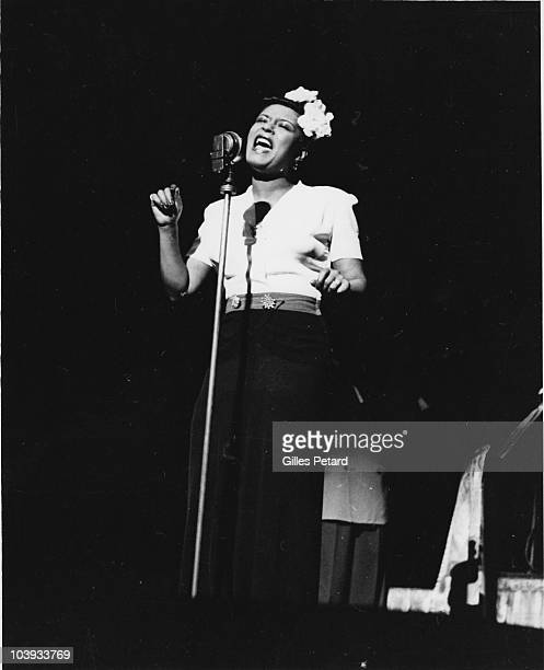 Billie Holiday performs on stage in 1950 in the United States