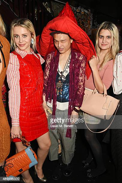 Billie JD Porter Adam Chen and Camille Benett attend the Love Magazine miu miu London Fashion Week party at Loulou's on September 21 2015 in London...