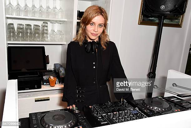 Billie JD Porter DJs at the opening of new restaurant Bronte on The Strand on July 13 2016 in London England