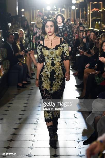 Billie JD Porter walks the runway during the Dolce Gabbana Italian Christmas at Harrods on November 2 2017 in London England