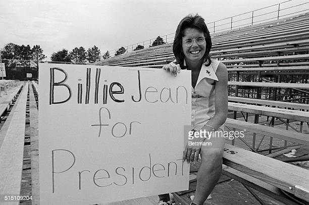 Billie Jean King 1973 Wimbledon Tennis Champion relaxes amid a sign fashioned by one of her many fans here Mrs King was drafted by Philadelphia's new...