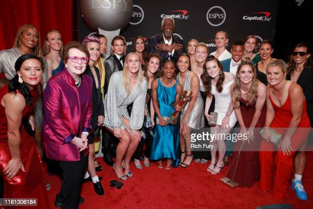 Billie Jean King and Bill Russell with members of the United States Women's National Soccer Team winners of the Best Team award pose during The 2019...