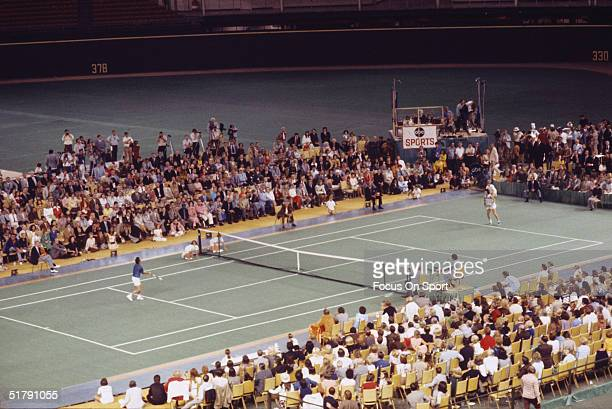 Billie Jean King and Bobby Riggs during the Battle of the Sexes Challenge Match at the Astrodome on September 20 1973 in Houston Texas