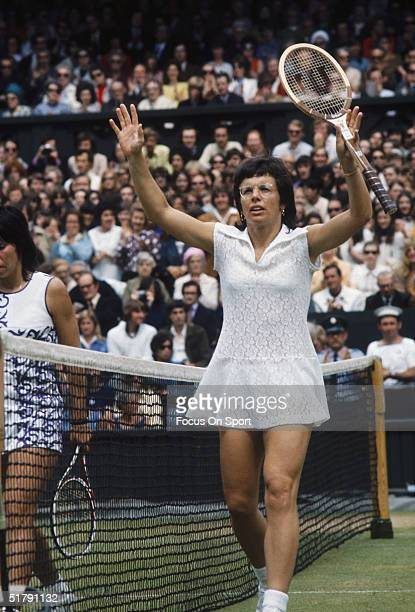 Billy Jean King gestures to the crowd near her opponent at the net during a game at the Women's Wimbledon Championships circa 1970's in London England