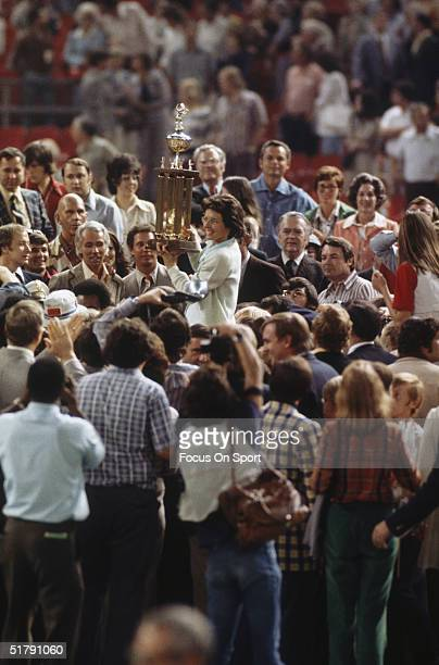 Billie Jean King holds up her trophy after defeating Bobby Riggs during the Battle of the Sexes Challenge Match at the Astrodome on September 20 1973...