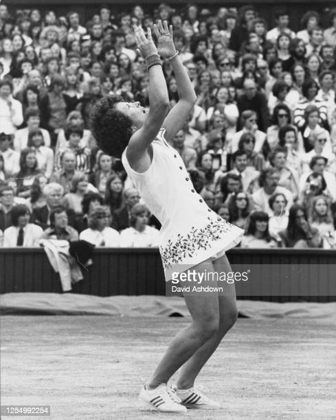 Billie Jean King of the United States holds her hands aloft after defeating Evonne Goolagong Cawley of Australia 6-0, 6-1 to win the Women's Singles...