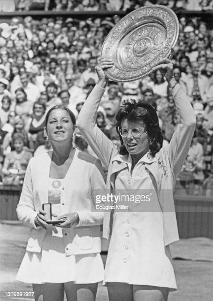 Billie Jean King of the United States holds the Venus Rosewater Dish aloft after defeating compatriot Chris Evert in their Women's Singles Final...