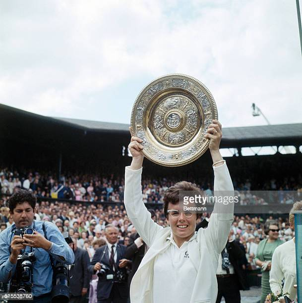 Billie Jean King of the United States holds up the Wimbledon trophy during the awards ceremony following her victory over PF Jones for the Women's...