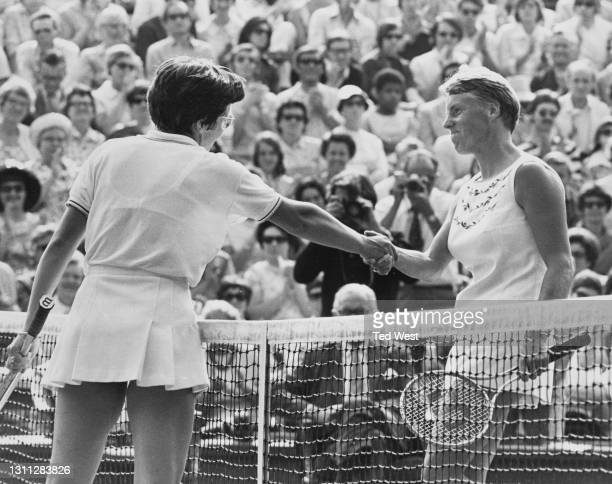 Billie Jean King of the United States reaches across the net to shakehands and commiserate with Ann Haydon-Jones of Great Britain following their...