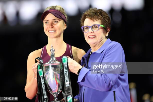 Billie Jean King presents Elina Svitolina of Ukraine the Billie Jean King trophy after winning the Women's Singles final on day 8 of the 2018 BNP...