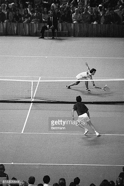 Billie Jean King reaches for a low volley in her tennis match against Bobby Riggs Riggs boasted earlier in the year that no woman could beat a male...