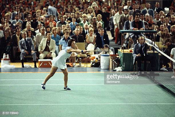 """Billie Jean King reaches for the ball in the first set of her match with aging Bobby Riggs for $100,000 winner-take-all """"Battle of the Sexes""""."""