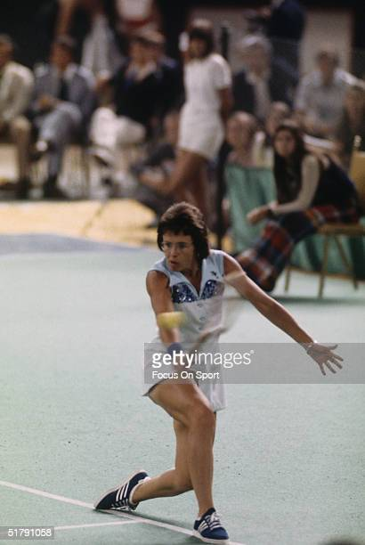 Billie Jean King returns a shot against Bobby Riggs during the Battle of the Sexes Challenge Match at the Astrodome on September 20, 1973 in Houston,...