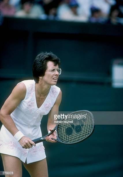 Billie Jean King stands on the court during a match at Wimbledon in England.