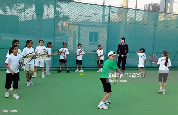 Billie Jean King watches children take part in her tennis mentoring clinic during the Sony Ericsson Championships at the Khalifa Tennis Complex on...