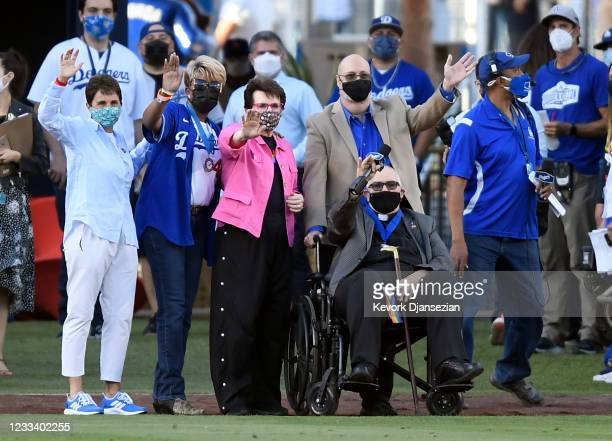 Billie Jean King waves to the crowd with honorees during a pre-game ceremony celebrating eighth annual LGBTQ+ Night at Dodger Stadium on June 11,...