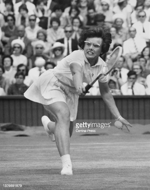 Billie Jean Moffitt of the United States looks at the tennis ball while playing a back hand return to Elizabeth Starkie of Great Britain during their...