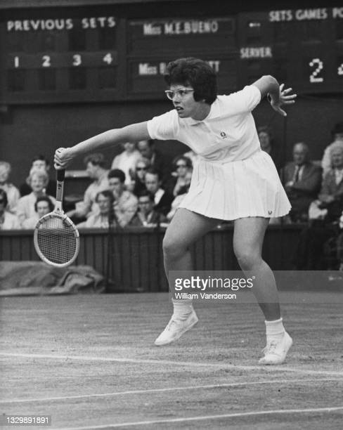 Billie Jean Moffitt of the United States plays a back hand return to Maria Bueno of Brazil during their Women's Singles Quarterfinal match at the...