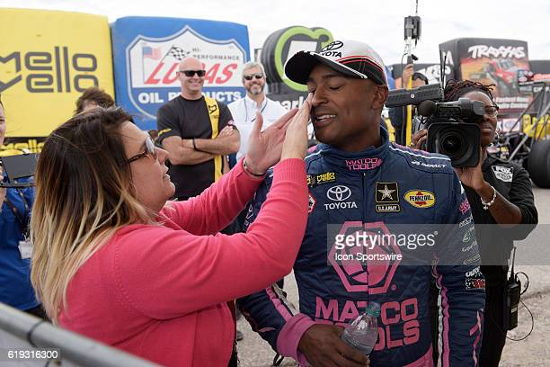 Billie Jo Brown jokes with her husband Antron Brown Don Schumacher Racing NHRA Top Fuel Dragster during the NHRA Toyota Nationals Sunday October 30...