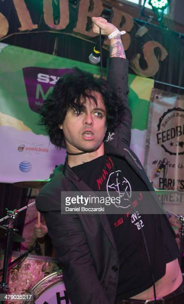 Billie Joe Armstrong aka Reverend Strychnine Twitch of Foxboro Hot Tubs performs on stage during Rachael Ray's Feedback at Stubb's on March 15 2014...