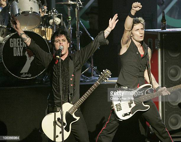 Billie Joe Armstrong and Mike Dirnt of Green Day during 2004 KROQ Almost Acoustic Christmas at Universal Amphitheatre in Universal City CA United...
