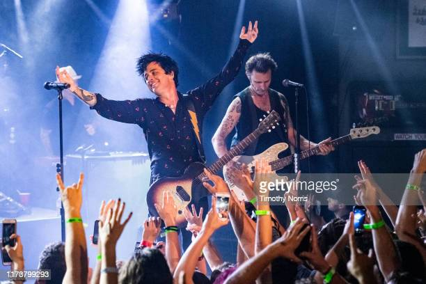 "Billie Joe Armstrong and Mike Dirnt of Green Day perform during the ""Hella Mega Tour"" announcement show at Whisky a Go Go on September 10 2019 in..."