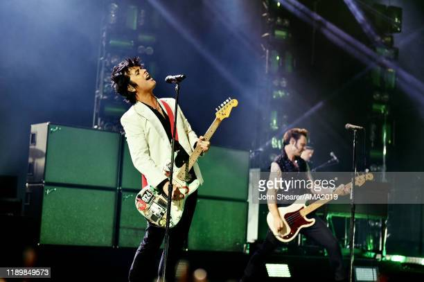 Billie Joe Armstrong and Mike Dirnt of Green Day perform onstage during the 2019 American Music Awards at Microsoft Theater on November 24 2019 in...
