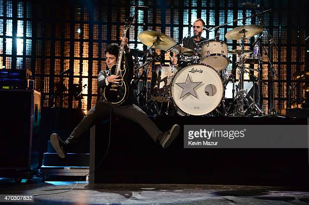 Billie Joe Armstrong and Ringo Starr perform onstage during the 30th Annual Rock And Roll Hall Of Fame Induction Ceremony at Public Hall on April 18...