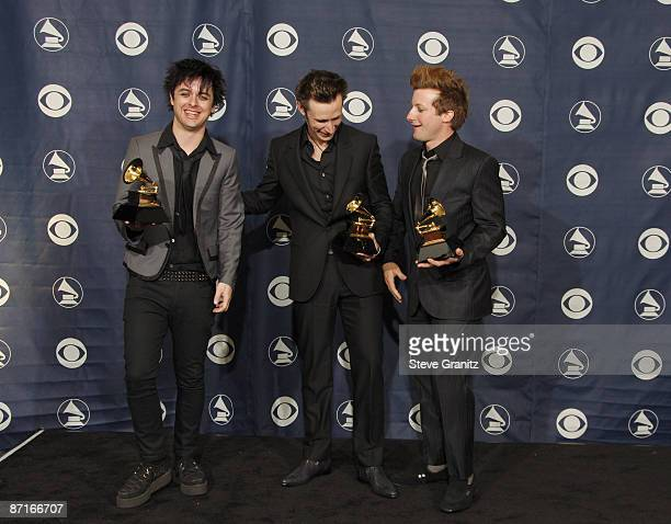 Billie Joe Armstrong Mike Dirnt and Tre Cool of Green Day winners of Record Of The Year for Boulevard Of Broken Dreams