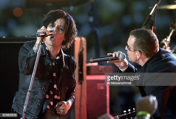 Billie Joe Armstrong of Green Day and Bono of U2 during a pregame concert inside the Louisana Superdome before the ESPN Monday Night Football game...