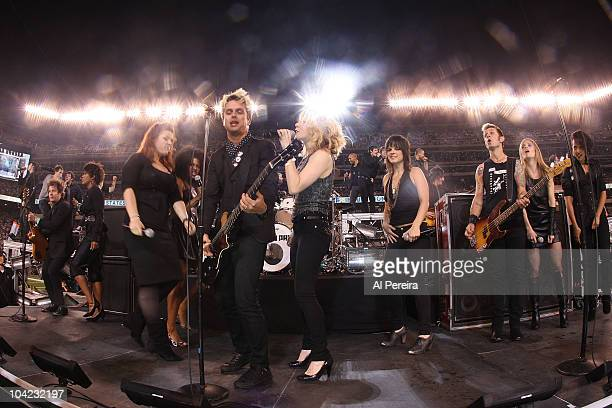Billie Joe Armstrong of Green Day are joined by the cast of 'American Idiot' on stage when Green Day performs at the New York Jet's 2010 opening game...