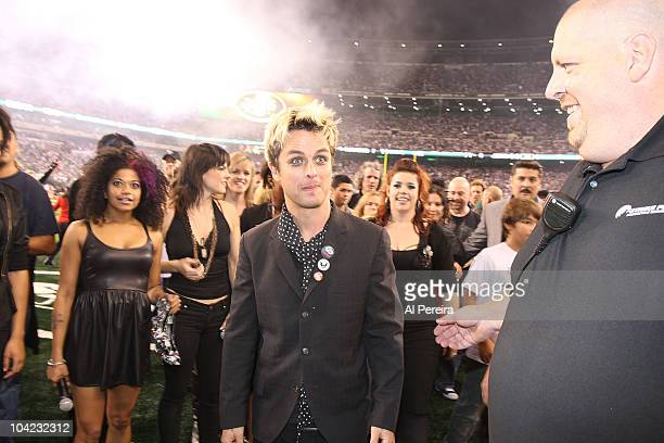 Billie Joe Armstrong of Green Day is joined by the cast of 'American Idiot' as they exit the stage when Green Day performs at the New York Jet's 2010...