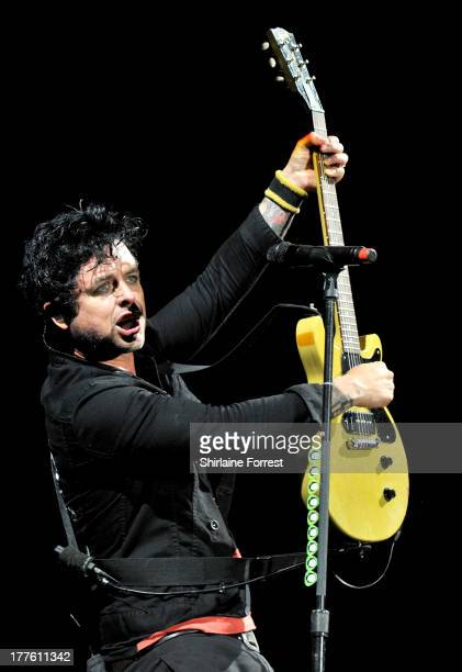 Billie Joe Armstrong of Green Day performs headling the main stage at Day 2 of the Leeds Festival at Bramham Park on August 24 2013 in Leeds England