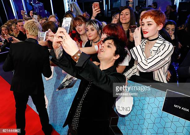 Billie Joe Armstrong of Green Day poses for a selfie with fans as he attends the MTV Europe Music Awards 2016 on November 6 2016 in Rotterdam...