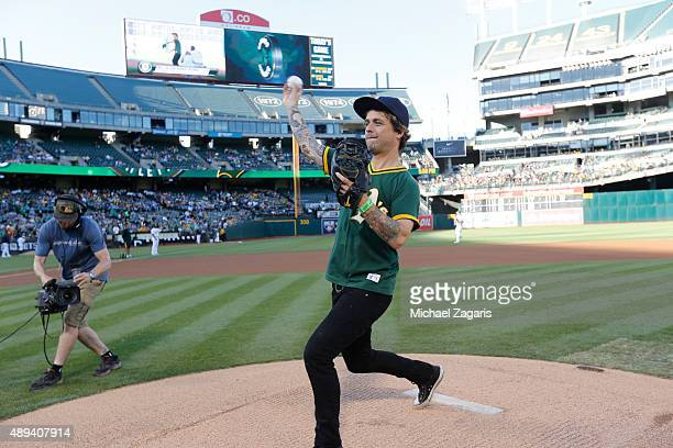 Billie Joe Armstrong of Green Day throws out the ceremonial first pitch prior to the game between of the Seattle Mariners and the Oakland Athletics...