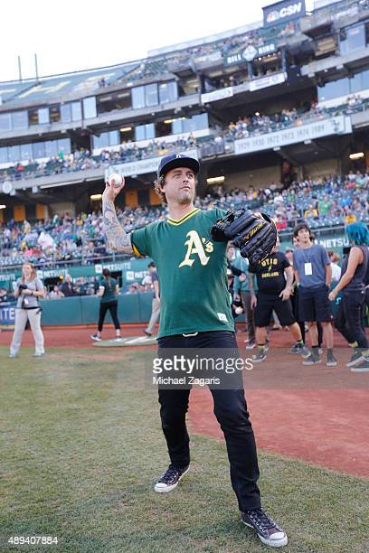 Billie Joe Armstrong of Green Day warms up on the field before throwing out the ceremonial first pitch prior to the game between of the Seattle...