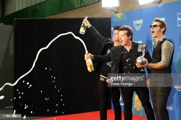 Billie Joe Armstrong Tre Cool and Mike Dirnt from Green Day with the Best Rock Award in the winners room during the MTV EMAs 2019 at FIBES Conference...