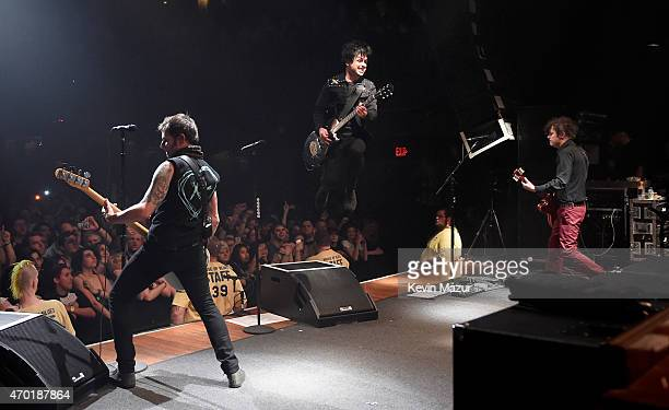 Billie Joe Armstrong Tre Cool and Mike Dirnt of Green Day perform onstage at House Of Blues on April 16 2015 in Cleveland Ohio