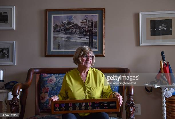 Billie Meeks is photographed in her home holding her father's WWII medals on May 11 2015 in Lewes De Billie Meeks wasnt even born when her father...